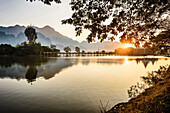 Mountains and bridge reflected in still lake, Hpa an, Kayin, Myanmar, Hpa an, Kayin, Myanmar
