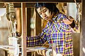 Asian girl weaving fabric, Bagan, Mandalay, Myanmar