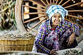 Asian girl selling herbs in market, Bagan, Mandalay, Myanmar