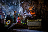 Asian girls lighting incense in temple, Hpa-An, Kayin, Myanmar