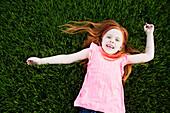 Caucasian girl laying in grass, Norfolk, Virginia, USA
