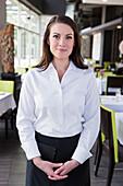 Caucasian waitress smiling in restaurant, Seattle, WA, USA