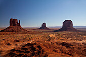 Butte rock formations in desert landscape, Monument Valley Tribal Park, Utah, United States, C1