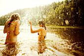 Girls splashing together in lake, Sarsy village, Sverdlovsk region, Russia