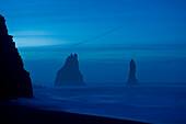 Rock formations in ocean at misty beach, Vik, Sudhurland, iceland