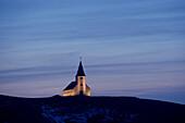 White church illuminated in remote landscape, Vik, Sudhurland, iceland