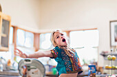 Caucasian girl singing indoors, Santa Fe, New Mexico, USA