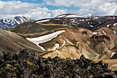 Snowy mountains and rhyolite formations in remote landscape, Landmannalaugar, Iceland, Iceland