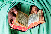 Close up of hands of priest holding Bible, Addis Ababa, Ntoto Hill, Ethiopia