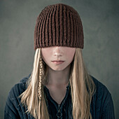 Teenage girl wearing knitted cap over eyes, Nizniy Tagil, Sverdlovsk, Russia