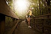 Caucasian woman stretching before exercise, Saint Louis, MO, USA