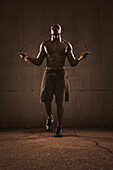 African American man jumping rope, Saint Louis, MO, USA