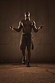 African American man jumping rope, Saint Louis, MO, USA