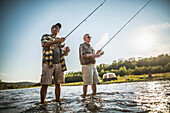 Caucasian father and son fishing in river, Saint Louis, Missouri, USA