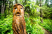 Close up of carved totem pole near forest path, Chelabinsk, Ural, Russia