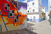 Morocco, Asilah, street in old medina, mural in foreground