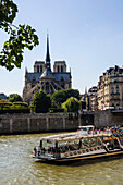 France, Paris, Bateau Mouche (excursion boat) along the Seine between Ile de la cité and Notre Dame cathedral