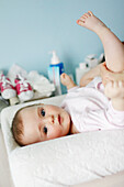 Little girl lying down on the changing table