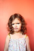 Portrait of a 4 years old girl pouting
