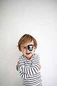 Portrait of boy wearing pirate costume