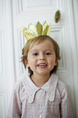 Little boy with a paper crown on the head