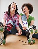 Friends putting on roller skates