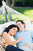 Couple relaxing in hammock