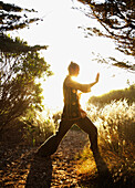 Caucasian man practicing tai-chi in remote area