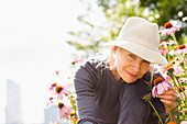Smiling Caucasian woman holding flower