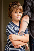 Caucasian boy holding father's hand