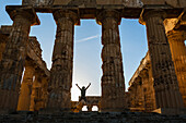 Caucasian man standing in Temple at Selinunte ruins, Selinunte, Sicily, Italy