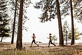 Caucasian women running in forest