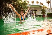 Woman playing in swimming pool