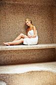 Caucasian woman relaxing in sauna