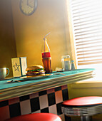 Burger and soda on diner counter