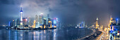 City skyline lit up at night, Shanghai, China