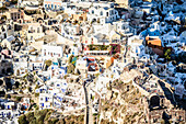 Aerial view of city on hillside, Oia, Egeo, Greece