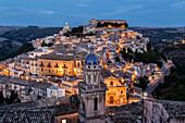 Hilltop town illuminated at dusk, Ragusa Ibla, Sicily, Italy
