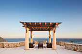Thatched roof patio overlooking ocean, Cabo San Lucas, BCS, Mexico