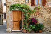Ivy and Flower Covered Doorway to Quaint Home in Cobblestone Alley, Pienza, Italy