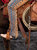 Close-Up of Cowboy's Leg with Foot in Stirrup
