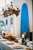 Dining Room with Autumn Centerpiece and Surfboard