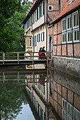 Benedictine Abbey at Burg Dinklage, moat, nun, Lower Saxony, Germany