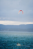 Man kite boarding strong winds in late afternoon, Victoria, Vancouver Island, British Columbia, Canada. (Photo by Henry Georgi/Aurora)