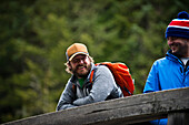 A couple of friends laugh together after fishing in Squamish, British Columbia.
