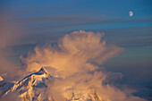 A storm brewing over Mount Hunter, as seen from 14.000 feet camp on Mount McKinley, also know as Denali, Alaska.     Mount McKinley, (native name Denali) is the highest mountain peak in North America, with a summit elevation of 20,321 feet (6,194 m) above