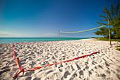 A beach volleyball court set up beside the ocean on Playa La Jaula beach, Cayo Coco, Cuba.