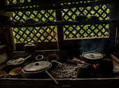 Pots and pans sit over a fire in the West coast of Dominica