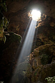 A ray of sun light enters the Calcehtok Mayan caves near Oxkintok in Yucatan Peninsula, Mexico. These caves are where for the ancient Mayans an entrance to Xibalba, the underworld.