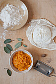 Flour, ricotta, mashed sweet potato, sage and nutmeg to make sweet potato gnocchi.